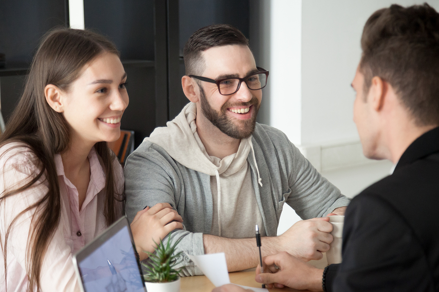 Excited Smiling Millennial Couple Discussing Retirement